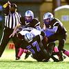John P. Cleary | The Herald Bulletin<br /> A host of APA tacklers converge on Wel-Del's Mason Whitted to bring him down.