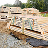 Don Knight | The Herald Bulletin<br /> Bundles of walls sit ready to be assembled on one of 19 new homes under construction.