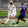 John P. Cleary | The Herald Bulletin<br /> Anderson University's Drew Sonnefeldt kicks the ball into their offensive zone as a Defiance defender moves in.