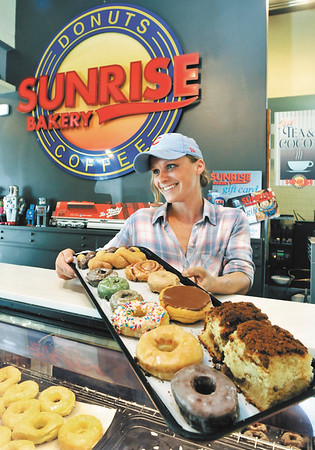 John P. Cleary   MADISON<br /> The Sunrise Bakery co-owner Katy Kitterman offers up an assortment of items made fresh daily at the Fortville bakery.
