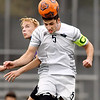 John P. Cleary | The Herald Bulletin<br /> Anderson University's Jacob Pokorski jumps high to get the header during play Wednesday against Defiance.
