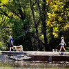 John P. Cleary | The Herald Bulletin<br /> With the temperatures reaching the mid to upper 80's, people enjoyed being out in the summer-like heat in October like this couple walking their dogs on the trails of Shadyside Park Monday afternoon.