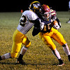 Don Knight | The Herald Bulletin<br /> Alexandria's Miller Abernathy breaks an attempted tackle by Shenandoah's Lucas Wuestefeld on Friday.