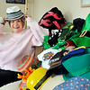 John P. Cleary | The Herald Bulletin<br /> Cancer survivor Judi Estes shows off some of her crazy hats she wore when going through treatments and had lost her hair. One of her favorites is the one she's wearing now.