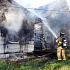 John P. Cleary | The Herald Bulletin<br /> House fire on West 22nd Street, just west of of Brown Street.