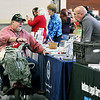 John P. Cleary | The Herald Bulletin<br /> Air Force veteran Patrick Ratcliff, of Indianapolis, talks with one of the many  representatives offering veteran assistance and aid at the Veteran's Stand Down event at national Guard Armory Friday.