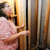 Don Knight | The Herald Bulletin<br /> Brenda Robinson stands in her unfinished bathroom. The Robinson's paid $2,000 of the $4,000 estimated by Brandon Seegraves to remodel their bathroom and make it handicap accessible.