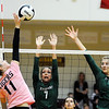 Don Knight | The Herald Bulletin<br /> Alexandria's Allyson Granger attacks the ball as Pendleton Heights Gracie Criswell, left, and Gracie King attempt to block her on Wednesday.