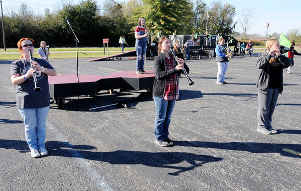 Don Knight   The Herald Bulletin<br /> Abby Ellis performs a clarinet solo while surrounded by a circle of woodwinds as the Alexandria Marching Tigers rehearse their ISSMA show on Thursday. The band has qualified for semi-state competition on October 27th.