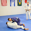 Don Knight | For The Herald Bulletin<br /> Brazilian Jui jitsu instructor Andrew Newkirk looks on as John Jarrett and Joel Heffelfinger practice a move during their class at the YMCA on Saturday.