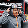 John P. Cleary | The Herald Bulletin<br /> Jay'vonn Murdock, 6, from Midnight Tot Spot daycare, adjusts his fireman's hat after going through a fire prevention and safety program at the Anderson Fire Department's Fire Safety House in the Anderson Public Library Thursday.