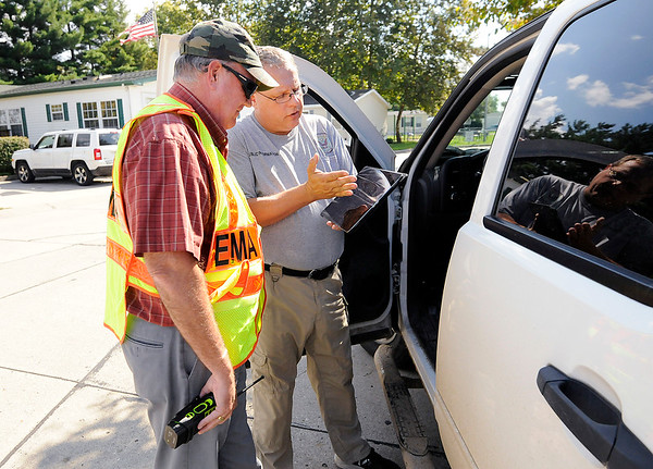 Don Knight | The Herald Bulletin<br /> EMA PIO Todd Harmeson briefs EMA Executive Director Tom Ecker on the area being evacuated  at the Royal Oaks trailer park as the Chesterfield Police Department, EMA and Vectren respond to a gas leak at the trailer park.
