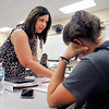 John P. Cleary | The Herald Bulletin<br /> Michelle Burnett helps one of her Algebra 2 students with her question at Alexandria-Monroe High School.