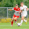 Don Knight | The Herald Bulletin<br /> Anderson's Ciara Quiroz and Fishers Allison Macbeth fight for control of the ball in the first round of the 3A Girls Soccer Sectional at Noblesville on Tuesday.