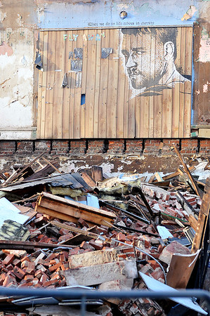 John P. Cleary | The Herald Bulletin<br /> Artwork was exposed as demolition work started Monday of the historic building at Harrison and Washington Streets in Alexandria which had started to collapse.