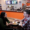 Don Knight | The Herald Bulletin<br /> From left, Karah Keller and David Leigh share a pretzel at Digital District on Saturday.