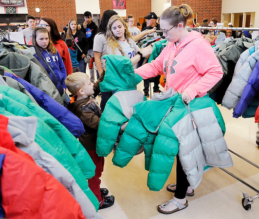 Don Knight | The Herald Bulletin<br /> Amber Short searches for the right size coat for her son Mason, 5, during Keith Trent's Coats of Caring at the Anderson High School on Saturday.