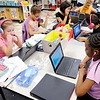 Don Knight | The Herald Bulletin<br /> Students in Brittany Gossard's 4th grade class at Anderson Elementary use their Chromebooks on Thursday. Clockwise from left are, Jacey Dillard Na'riaha Turner, Kira Perkins, Briana Hernandez-Miranda and Taylor Dixon.
