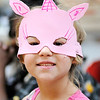 Don Knight | The Herald Bulletin<br /> Emily Fauss, 7, wears the mask she created during Family Fun Day at the Anderson Museum of Art on Saturday.