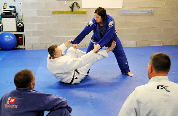 Don Knight | For The Herald Bulletin<br /> Brazilian Jui jitsu instructor Andrew Newkirk demonstrates a move with the help of his wife Kelly during class at the YMCA on Saturday.
