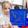 John P. Cleary | The Herald Bulletin<br /> Phoenix Meredith shows what she has created on her geo board in Rachel Dilts Summitville Elementary School Pre-K class that is part of the  Argyll Adventure Academy.