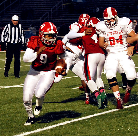 M.J. Armstrong carries the ball upfield for the Anderson Indians during their home game against Richmond.