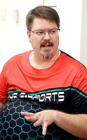 AHS calculus teacher Richard Ziuchkovski is the faculty sponsor for the Anderson High School E-Sports Club.
