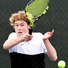 Jesse McCurdy, of Lapel, eyes the ball as he returns it during his IHSAA Singles State Finals quarterfinal match against Daniel Pries of South Bend St. Joseph.