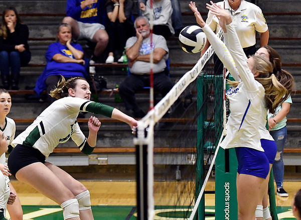 Pendleton's Averi Lanman gets a kill against Greenfield-Centrals defense.