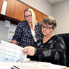 Alexandria Clerk-Treasurer Jill Scott, right, and her deputy Erika Hobbs go over the city's budget.