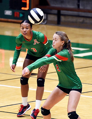 Anderson's Katie Wynne closes her eyes as she returns a serve during their match against Mt. Vernon.