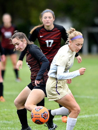 Anderson University's Emily Albert and Defiance's Chelsey Strawser try to stop and turn toward the ball during their match Wednesday afternoon.