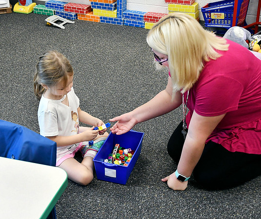 John P. Cleary | The Herald Bulletin<br /> Rachel Dilts, right, Pre-K teacher at Summitville Elementary School, works with student Phoenix Meredith in the Argyll Adventure Academy.