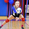 Elwood's Kori Wilkey gets in position to return a serve.