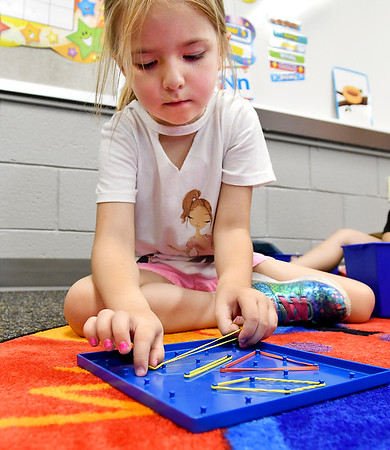 John P. Cleary | The Herald Bulletin<br /> Phoenix Meredith creates different shapes and patterns on a geo board in Rachel Dilts Summitville Elementary School Pre-K class that is part of the  Argyll Adventure Academy.