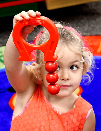 John P. Cleary | The Herald Bulletin<br /> Rebecca Gunter learns about magnets as she plays with these magnetic items in Rachel Dilts Summitville Elementary School Pre-K class that is part of the  Argyll Adventure Academy.