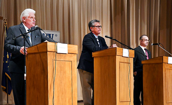 Democrat incumbent Thomas Broderick Jr., left, answers a question as Rick Gardner, center, Republican challenger, and Rob Jozwiak, Libertarian challenger, wait their turn to respond during the Anderson Mayoral forum Thursday evening.