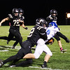 Chris Martin for The Herald Bulletin.  Lapel's Kyle Shelton tackles an Eastern Hancock rusher Friday night at home.