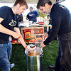 Purdue Polytechnic student Lorne Lewellen pours a bowl of chili as Purdue Polytechnic student affairs administrator, Ric Dwenger, stirs the large pot of soup Wednesday as they served up their recipe for the 34th annual Red Gold Chili Cook-Off this Saturday to staff and students at the school to gain feedback before the contest.
