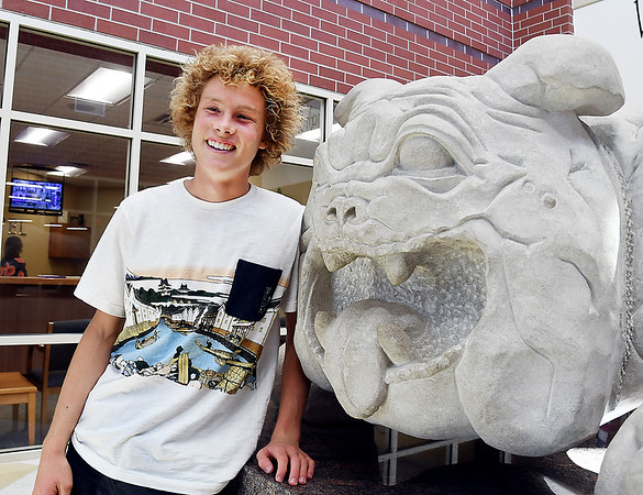 John P. Cleary | The Herald Bulletin<br /> Jesse McCurdy, a National Merit semi-finalist from Lapel High School, with the school mascot that greets people at the main entrance of the school.