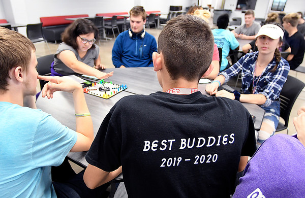 Members of the Best Buddies program at Frankton High School gather together in the cafeteria for activities and games.