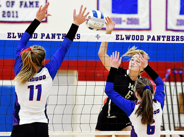 Madison-Grant's Emma hits the ball as Elwood's defenders, Jaleigh Crawford and Ella Flanagan jump to block.