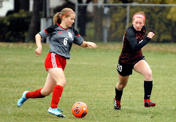 Anderson University's Morgan Reed races Rose-Hulman player Jessica Wells for the ball.