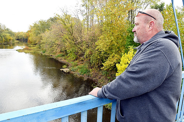 Chris Parrish looks out over White River from the pedestrian bridge at Edgewater Park where he contemplated committing suicide when his life started to unravel.