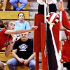 Frankton's Kate Sperry, left, attempts a kill against Liberty Christian's Maddy Harmon but the ball was deflected by the net to keep it in play.