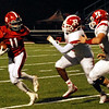 Anderson running back Trey Jordan breaks away from Richmond defenders.