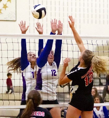 Elwood's Hannah Everson works to block the ball as Elwood took on Wapahani during Thursday nights sectional matchup.