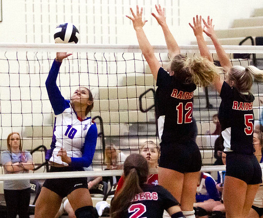Elwood's Morgan Scott drives the ball across the net Thursday night during Elwood's matchup against Wapahani.