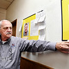 Kenny Kadinger, Anderson Moose Lodge administrator, points to photos along the hallway of the family center that displays individuals the lodge helps support that are at Moose International's Mooseheart in Chicago of Moosehaven in Florida.