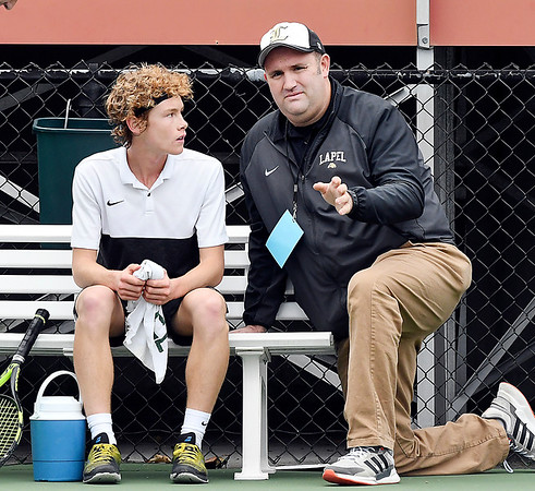 Jesse McCurdy, of Lapel, listens as his coach, Justin Coomer, talks to him between games of his IHSAA Singles State Finals quarterfinal match.